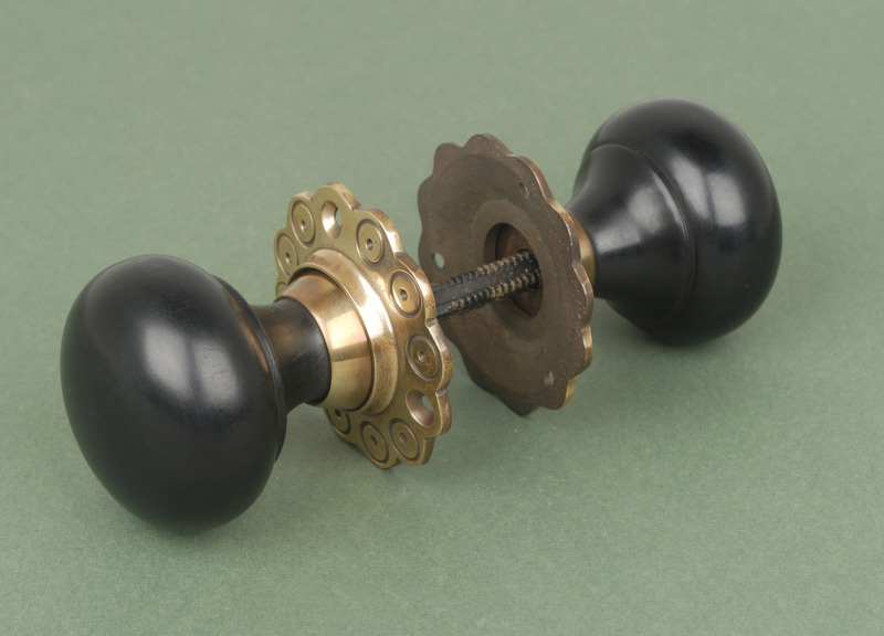 - Solid Ebony Bun Door Knobs Brass Backplate
